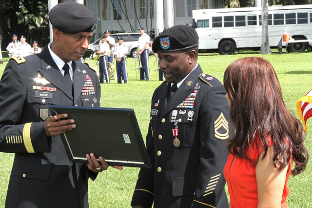 Gen. Brooks presents retirement certificate to Sgt. 1st Class Foster K. Folger