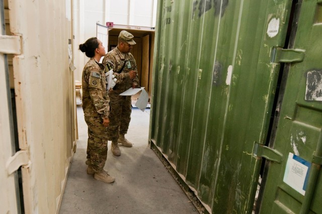 Chief Warrant 3 John Rosa (right), who serves as the senior mobility warrant officer for 1st Cavalry Division and Regional Command-South, inspects the exterior of a storage container and gives advice to1st Lt. Debora Pleitez, an assistant supply officer for the 2nd Battalion, 504th Parachute Infantry Regiment, 1st Brigade Combat Team, 82nd Airborne Division, during inspection on Kandahar Airfield, Afghanistan, Sept. 27, 2014. Rosa assists in conducting inspections for all of coalition forces on KAF to ensure that they are following their established downgrade timelines in preparation for the Resolute Support Mission, which begins Jan. 1.