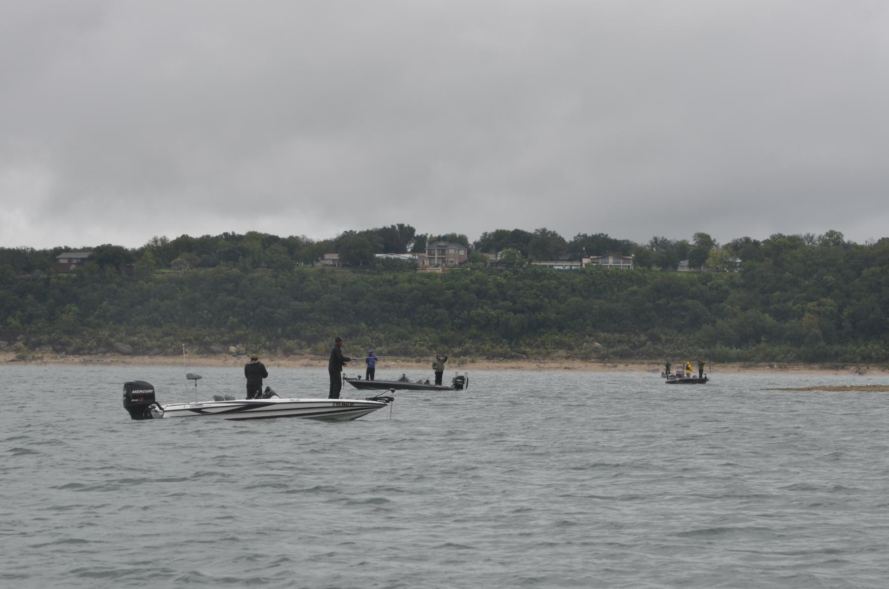 Fishing for freedom tournament anglers get drenched while for Bass fishing in the rain