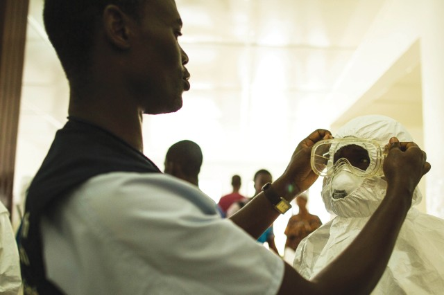 Health-care workers put on personal protective equipment before going into the hot zone at Island Clinic in Monrovia, Liberia, Sept. 22. As the U.S. helps to combat the spread of Ebola virus in Africa, Fort Benning's chief of preventative medicine said the disease is unlikely to spread in the U.S.
