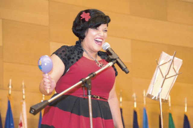 Rachel Acevedo, from the Civilian Human Resources Agency, sings Un Lugar Celestial (Heavenly Place) by Jaci Velásquez during the APG observance of National Hispanic Heritage Month at the Myer Auditorium Oct. 1.