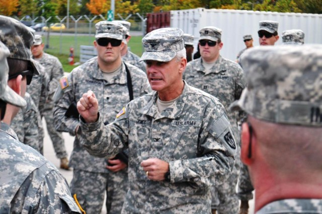 Col. Zane Jones, commander of the 18th Military Police Brigade, gives parting words to Soldiers from the 902nd Engineer Company, 15th Engineer Battalion, before they depart, Oct. 15, 2014, to help Ebola victims in West Africa.