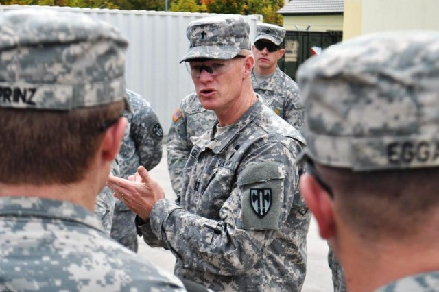 Chaplain Steven Glenn, 15th Engineer Battalion, gives parting words and a blessing to Soldiers from the 902nd Engineer Company before they depart, Oct. 15, 2014, to help Ebola victims in West Africa.