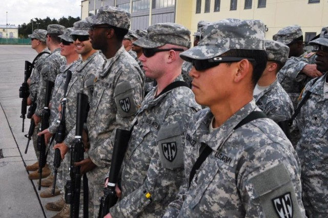 Vertical construction engineers from the 902nd Engineer Company, 15th Engineer Battalion, prepare to deploy, Oct. 15, 2014, to help Ebola victims in West Africa.