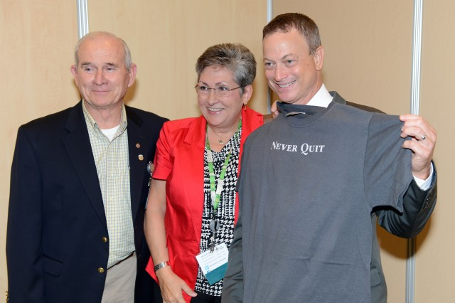 Actor Gary Sinise displays a T-shirt he received Oct. 14, 2014, from Gold Star parents Ed and Candis Martin, of San Antonio at the Washington Convention Center, where Sinise spoke during AUSA Military Family Forum II.