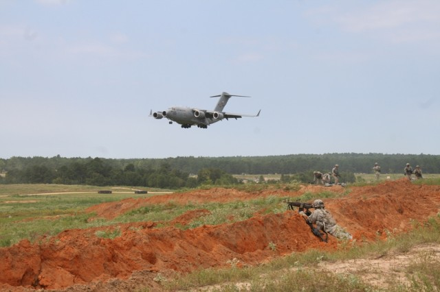 A C-17 aircraft lands on an airfield secured by the 2nd Brigade Combat Team/82nd Airborne Division during early entry training mission at the Army's Joint Readiness Training Center (JRTC) at Fort Polk, La., on September 22, 2014. The JRTC rotation provided the unit the opportunity to train with and validate its new Capability Set 14 network communications equipment down to the Soldier level in a complex and challenging combat environment.  (U.S. Army photo by Amy Walker, PEO C3T).