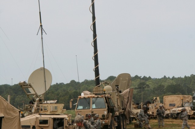 A Warfighter Information Network-Tactical (WIN-T) Increment 2 Tactical Communications Node (TCN)(center) is utilized by 2nd Brigade Combat Team/82nd Airborne Division at the Joint Readiness Training Center (JRTC) at Fort Polk, La., on September 22, 2014. The TCN provides the Tactical Operations Center and Tactical Command Post with communication and networking equipment [line-of-sight and satellite communications] both on-the-move and at-the-halt to battalion and above echelons.  While at-the-halt, the TCN is equipped with a 10-meter extendable mast to improve line-of-sight connectivity. (U.S. Army photo by Amy Walker)