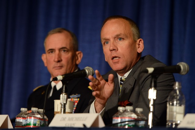 Under Secretary of the Army Brad Carson speaks on a panel about the human dimension, at the Association of the United States Army's Annual Meeting and Exposition, Washington, D.C., Oct. 15, 2014.