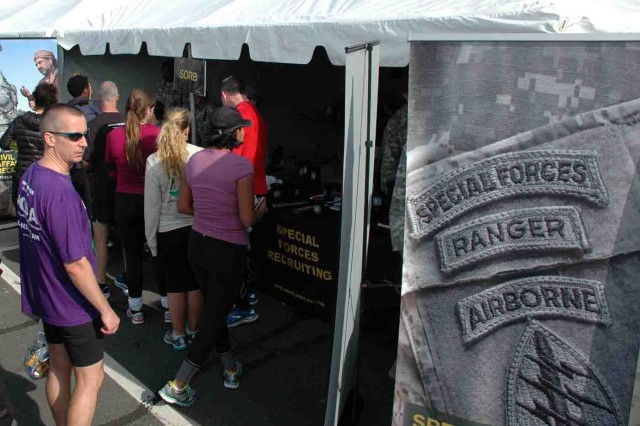 Some of the Army Ten Miler's 26,238 finishers visit the Special Operations Recruiting Battalion booth in the Hooah Zone Oct. 12 at the Pentagon.
