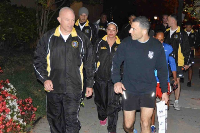 From left, Lt. Col. Michael Stinnett and Capt. Abigail Tassa, New York City Recruiting Battalion, and Lt. Col. Darin Blatt, Tampa Recruiting Battalion, make their way to the Army Ten Miler start line early Oct. 12 in Crystal City, Virginia.