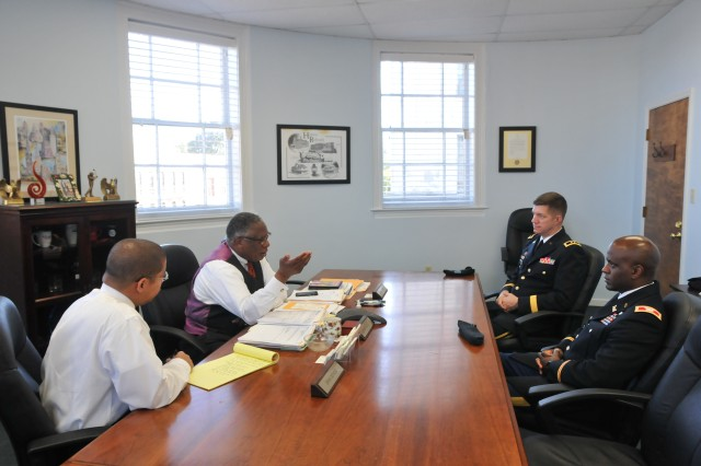 Maj. Gen. Tracy Thompson, commanding general, 412th Theater Engineer Command, and Vicksburg Mayor George Flaggs, Jr., discuss important matters mutually beneficial to the 412th TEC, Army Reserve and the local community during an office call held at the mayor's office in downtown Vicksburg, Miss., Oct. 17, 2014.
