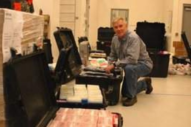 Dr. Randal Schoepp, with the U.S. Army Medical Research Institute of Infectious Diseases, inspects packing cases filled with laboratory supplies prior to departing for Liberia, Sept. 25, 2014, to support Ebola virus diagnostic efforts.