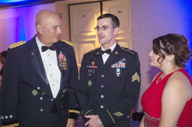 Army Chief of Staff Gen. Ray Odierno speaks with Sgt. Andrew Mahoney at the 2014 Honoring Those Who Serve Gala in Washington, D.C., Oct. 17, 2014. Mahoney was the United Service Organization Soldier of the Year award recipient. Mahoney helped tackle a suicide bomber near the provincial governor's compound in Asadabad, Afghanistan, saving the lives of 24 people.