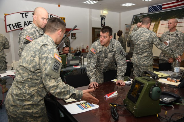 Lt. Col. Kyle Reed (right), commander of 1st Squadron, 91st Cavalry Regiment, 173rd Airborne Brigade, briefs his staff on mission expectations, Oct. 21, 2014, at Grafenwoehr Training Area, Germany, as part of a brigade Emergency Deployment Readiness Exercise. The paratroopers parachuted into NATO ally Romania for training, roughly 24 hours after initial notification to test their readiness as the U.S. Army Contingency Response Force in Europe.