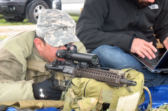 A member of the U.S. Army Special Forces, left, demonstrates the Rapid Adaptive Zoom for Assault Rifles prototype developed at Sandia National Laboratories. (Photo courtesy of Sandia National Laboratories)