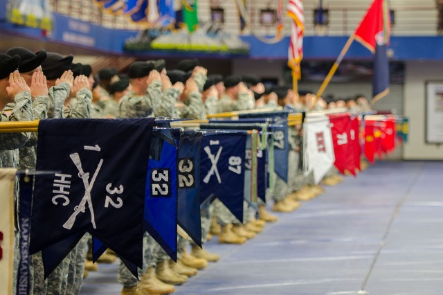 Company unit colors of the 1st Brigade Combat Team, 10th Mountain Division (LI) render a salute during a transformation ceremony Friday at Magrath Sports Complex to officially recognize the Warrior Brigade's alignment with the Army's brigade combat team restructuring initiative.