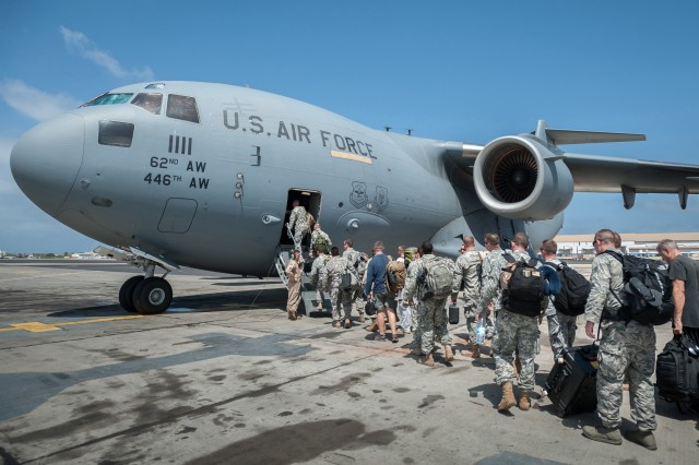 Soldiers from the 101st Airborne Division (Air Assault) and troops from the other services board an Air Force C-17 in Dakar, Senegal, Oct. 19, 2014. The troops are bound for Monrovia, Liberia, where they will construct medical treatment units and train health care workers as part of Operation United Assistance, the U.S. Agency for International Development-led, whole-of-government effort to respond to the Ebola outbreak in West Africa.