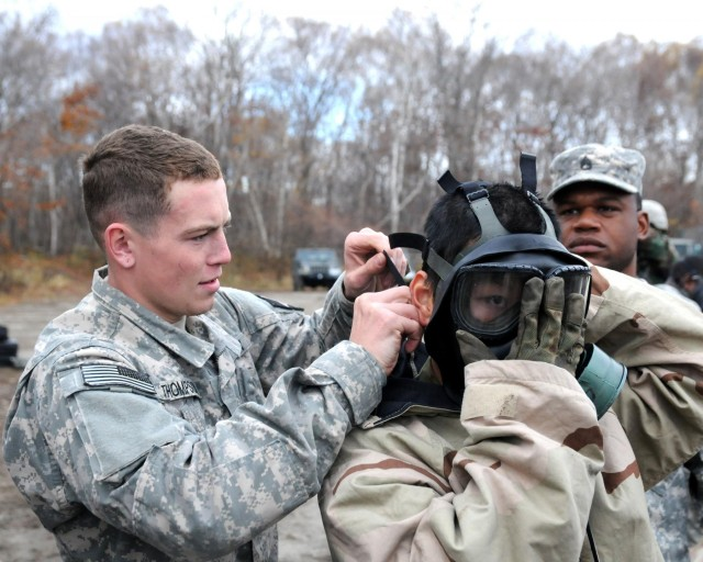 US Army Soldiers display chemical protective equipment during Orient Shield 14