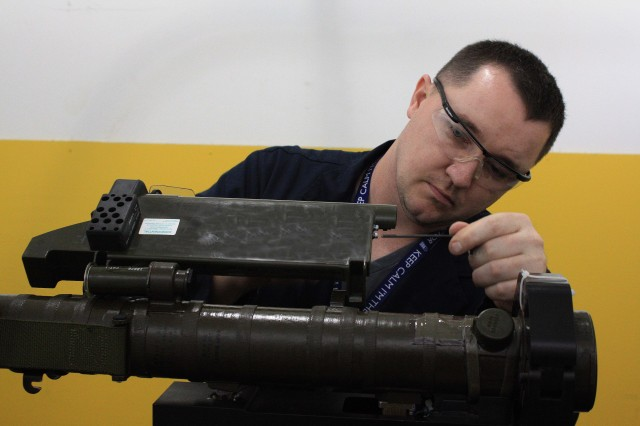 Matthew Thomas, an electronic integration system mechanic journeyman in the Precision Munitions Division, Ammunition Operations Directorate at McAlester Army Ammunition Plant, Okla., makes some adjustments to an aging FIM-92E Stinger missile on the Guided Missile Intercept Aerial test equipment, to determine which components can be used on the nearly $11 million upgrade project for Cruise Missile Defense Systems from Redstone Arsenal, Ala.