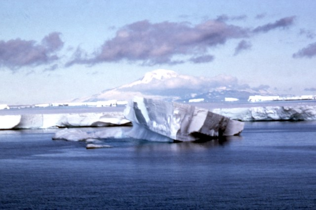 An iceberg floats past an ice shelf in the North Atlantic.