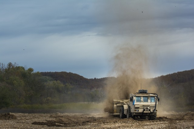 "Soldiers from the 364th Engineer Platoon (Area Clearance), headquartered in Pine Bluff, Ark., train on the newly-fielded M1271 Mine Clearing Vehicle, also known as the Medium Flail, Oct. 29, 2014, during a week-long course designed as a team-oriented training event at Fort Leonard Wood, Mo. The 364th En. Plt., with the Army Reserve, is the first unit across the entire Army to receive and train on this vehicle. The rotating arm has approximately 70 ""hammers"" at the end of heavy-duty chains, spinning at a rate of 3,500 revolutions per minute."