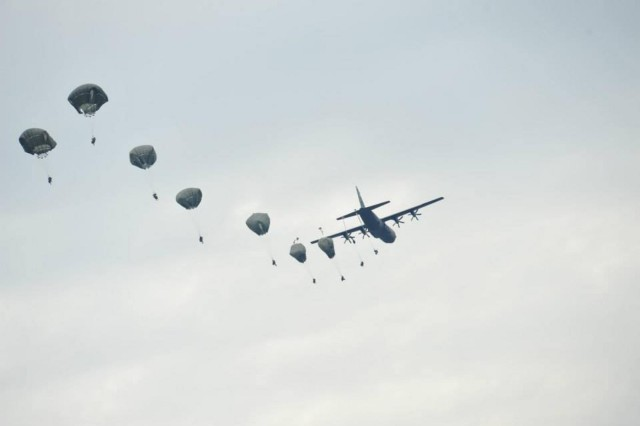 Parachutists from the 1st Squadron, 91st Cavalry Regiment, 173rd Airborne Brigade, exit a U.S. Air Force C-130 Hercules aircraft during an emergency deployment readiness exercise at Bogata, Romania, Oct. 21, 2014.