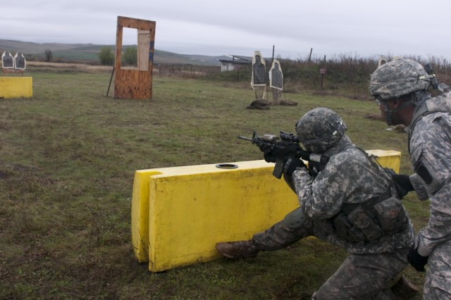 First Lt. Steven Erzinger, a platoon leader with 1st Squadron, 91st Cavalry Regiment, 173rd Airborne Brigade, aims at a target during a stress shoot competition during an emergency deployment readiness exercise in Bogata, Romania, Oct. 23, 2014.