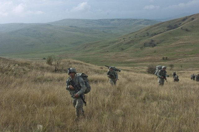 Paratrooper from the 1st Squadron, 91st Cavalry Regiment, 173rd Airborne Brigade, ascends a mountain during an emergency deployment readiness exercise in Calarasi, Transylvania, Romania, Oct. 22, 2014.