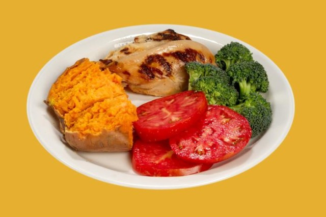 This white ceramic plate had been topped with a healthy, balanced meal consisting of a broiled chicken breast, half a sweet potato, three slices of bright red tomato, and some steamed broccoli florets, and measured 293 calories in its entirety. Eating low-fat meals with fruits, vegetables and whole-grain foods can lower your risk of developing Type 2 diabetes.