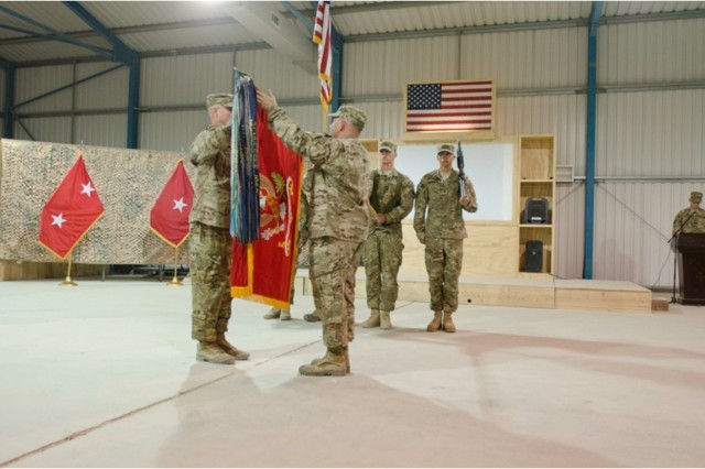 Lt. Col. B.J. Herman, commander, 5-5 ADA and 5-5 ADA Command Sgt. Maj. Jerry Jacobitz, uncase the Battalion Colors during the Transfer or Authority ceremony on October 24th at Bagram Airfield, Afghanistan.