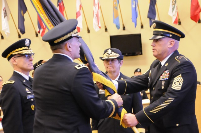 Command Sgt. Maj. Ronald G. Law of the 81st Regional Support Command passes the unit colors for the last time to Maj. Gen. Gill P. Beck during a Change of Command ceremony where Maj. Gen. Beck relinquished command of the 81st RSC to Maj. Gen. Janet L. Cobb. The ceremony was held at Fort Jackson, S.C. on November 2, 2014. U.S. Army photo by Sgt. Kandi Huggins, 81st Regional Support Command Public Affairs.