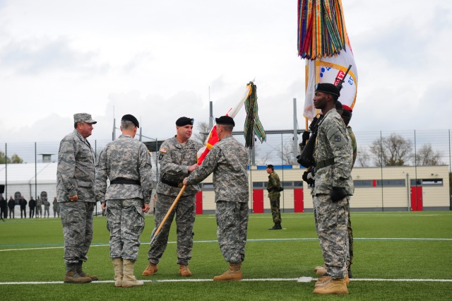 Lt. Gen. Ben Hodges (center, facing camera) passes the U.S. Army Europe colors to Command Sgt. Maj. David S. Davenport Sr., USAREUR senior enlisted advisor, during the ceremony in which Hodges accepted command of USAREUR, in Wiesbaden, Germany, Nov. 5. The traditional flag-passing symbolizes the transition of command from one leader to another.
