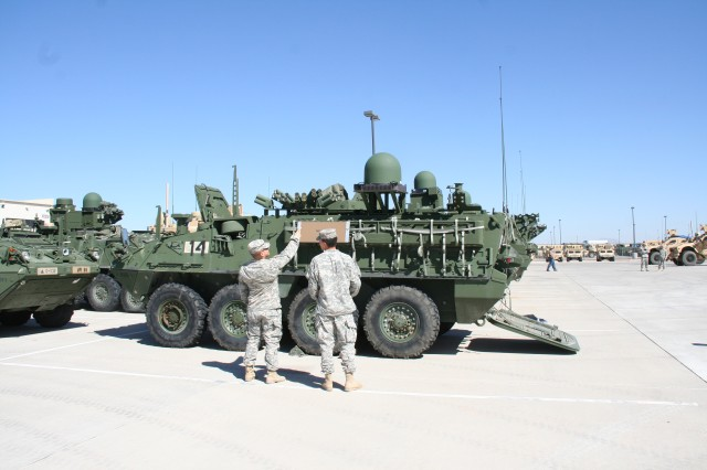 Soldiers from the 1st Stryker Brigade Combat Team (BCT), 1st Armored Division receive Warfighter Information Network-Tactical (WIN-T) Increment 2 new equipment training on Oct. 24, 2014 at Fort Bliss, Texas. This is the second Stryker BCT to be fielded with WIN-T Increment 2, the Army's mobile tactical network communications backbone. (U.S. Army photo by Amy Walker, PEO C3T)
