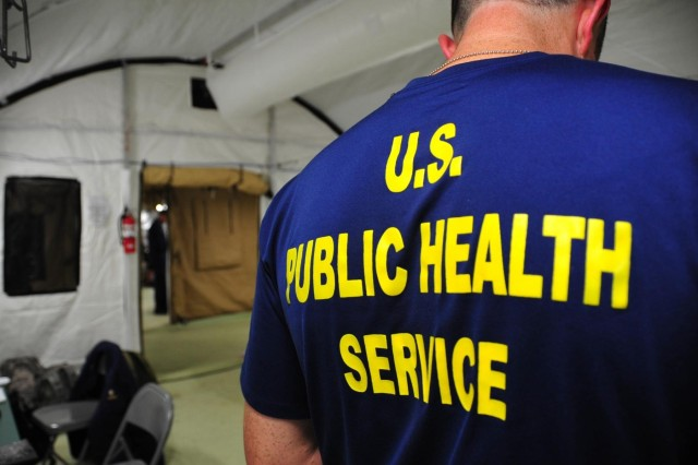 A U.S. Public Health Service officer helps put the final touches on the administrative area of the Monrovia Medical Unit Nov. 4, 2014, located 30 miles outside of Monrovia, Liberia. The Monrovia Medical Unit is divided into two zones: the low-risk zone, where the administrative and staff areas are, and the high-risk zone, where patients are cared for.