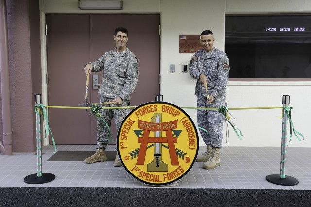 Lt. Col. Joshe E. Raetz, 1st Battalion, 1st Special Forces Group Commander and Lt. Col. Eric A. Martinez, U.S. Army Garrison - Okinawa Commander, cut the ribbon to the new 1st Bn., 1st SFG Headquarters building at Torii Station Nov. 4.