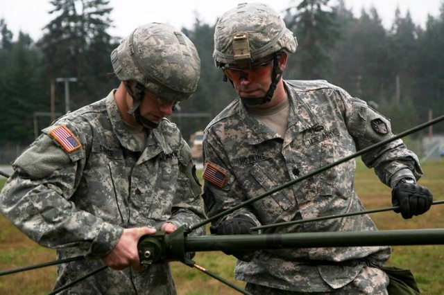 Soldiers from the 110th Chemical Battalion, participate in the communication station during the Iron Dragon Leader Certification Course, on Joint Base Lewis-McChord, Wash., Oct. 30, 2014.