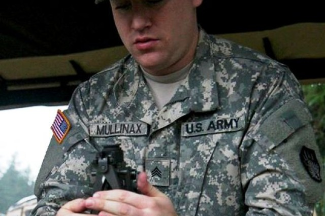 A Soldier from the 110th Chemical Battalion participates in the communication station during the Iron Dragon Leader Certification Course, on Joint Base Lewis-McChord, Wash., Oct. 30, 2014.