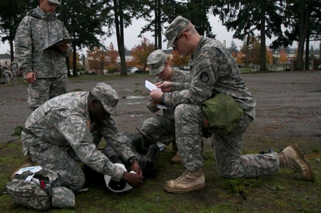Soldiers from the 110th Chemical Battalion, participate in the medical station during the Iron Dragon Leader Certification Course, on Joint Base Lewis-McChord, Wash., Oct. 30, 2014.