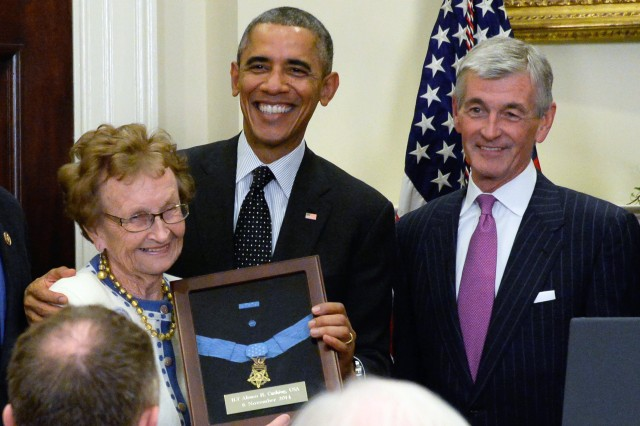 President Barack Obama awards the Medal of Honor to 1st Lt. Alonzo H. Cushing for his gallantry during combat at Gettysburg July 3, 1863. Receiving the medal at the White House ceremony, Nov. 6, 2014, is Helen Loring Ensign, Cushing's first cousin, twice removed. Some 24 other descendants were present as well. To the president's immediate right is Secretary of the Army John M. McHugh.