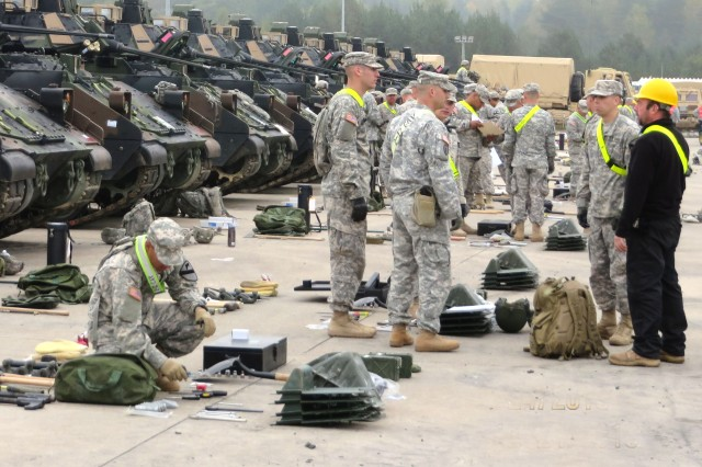 """Soldiers of the 2-12th Combined Arms Battalion, 1st Brigade Combat Team """"Ironhorse,""""  1st Cavalry Division, based out of Fort Hood, Texas, inspect equipment from the European Activity Set, Oct. 4-7, 2014, in Grafenwoehr, Germany."""