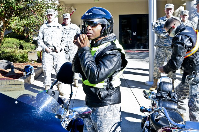 U.S. Army Reserve Soldier Maj. Earl Ervin with the 412th Theater Engineer Command dons his safety equipment before participating in his first motorcycle safety ride round-trip from the 412th TEC in Vicksburg, Miss., to Natchez, Miss., Nov. 1. (U.S. Army photo by Staff Sgt. Roger Ashley)