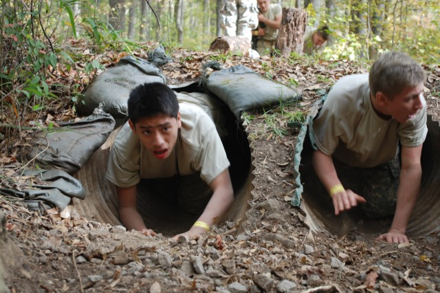 The gauntlet course features a one-mile run and obstacles like the twin tunnels through, which participants must crawl through.