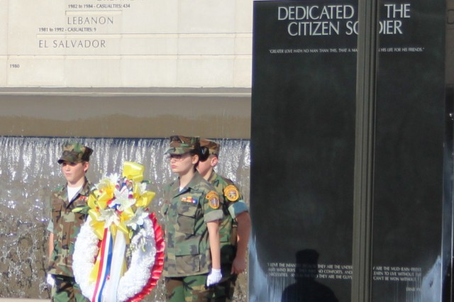Members of the Rocket City Marines and Young Marines present the wreath at the Global War on Terrorism section of the Veterans Memorial at the Day of the Deployed ceremony Sunday.