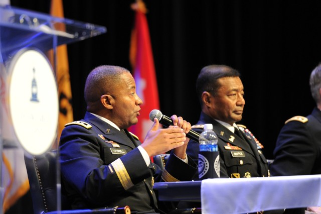 Lt. Gen. Robert S. Ferrell, Army chief information officer/G-6, addresses questions from Reserve Officer Training Corps Cadets. At his right is Lt. Gen. Thomas P. Bostick, chief, Corps of Engineers.
