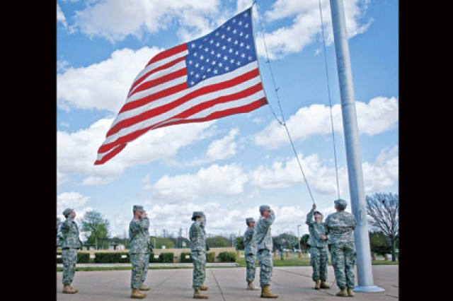 Soldiers render honors as the flag is lowered during Retreat. All APG drivers - service members and civilians - will be expected to stop and render honors during Reveille and Retreat in accordance with AR 600-25 when bugle calls return to APG starting Nov. 8.