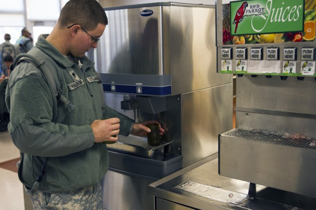"Army Reserve Spc. Robert Valentine, from Kelso, Washington, fills up a glass of water at a Fort Knox Dinning Facility during annual training. Valentine is a light-wheeled vehicle mechanic with the 800th Military Police Company, based in El Dorado, Arkansas. Valentine and nearly 400 Army Reserve Soldiers assigned to the 290th Military Police Brigade are participating in a two-week Performance Triad during their annual training. The focus of the Performance Triad is on Sleep, Activity, and Nutrition - key actions that influence health in the ""Lifespace"" of time that isn't spent with a health-care provider. (Army Reserve Photo by Sgt. 1st Class Mark Bell/Released)"
