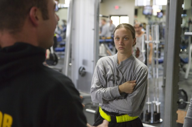 Army Reserve Pfc. Kayla Fillyaw talks with a master fitness trainer as part of the pilot Performance Triad at Fort Knox. Fillyaw, a 26-year-old military police Soldier from Macclenny, Florida said her entire life has been dealing with her weight gains and losses, and now she battles to maintain a healthy weight to stay in the Army. Fillyaw is assigned to the 351st Military Police Detachment. Fillyaw and nearly 400 Soldiers assigned to the 290th MP Brigade are spending 14-hour days learning about nutrition, sleep and fitness during a two-week program. (Army Reserve Photo by Sgt. 1st Class Mark Bell/released)