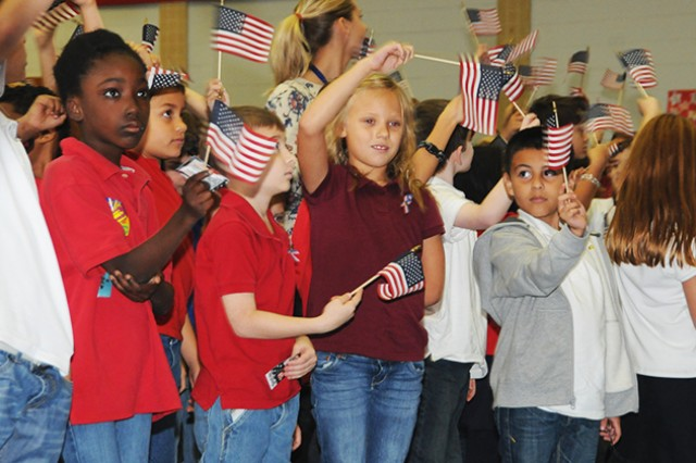 Fort Rucker Elementary School students wave flags as they honor America's veterans during a Veterans Day ceremony at the school Nov. 10.