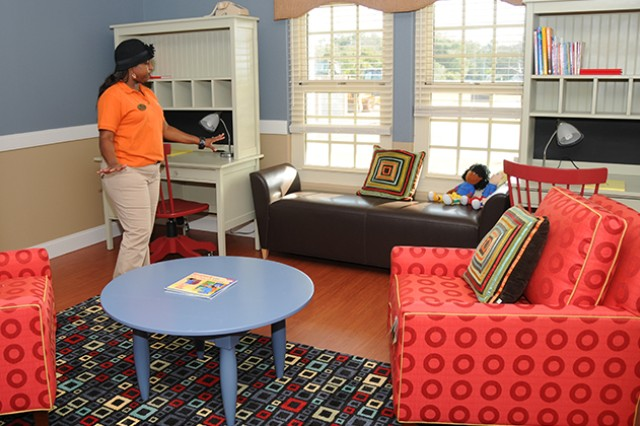 Sasha LaForge, supervising program specialist for the CDC, showcases the sitting and reading area in the Mini CDC. The Mini CDC is now open for 24/7 childcare for children ages six weeks to 11 years old.