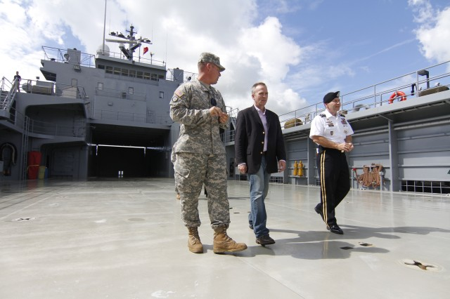 Chief Warrant Officer 4 Francis Lloyd (left), the skipper of the U.S. Army Vessel Lt. Gen. William B. Bunker (Logistic Support Vessel-4), discusses the joint and multi-national role Army watercraft play across the Pacific Theater with Under Secretary of the Army Brad R. Carson (center) and Maj. Gen. Edward F. Dorman III (right), commander of the 8th Theater Sustainment Command, during a tour of the vessel, Nov. 15, 2014, at Joint Base Pearl Harbor-Hickam, Hawaii. The vessel is one of the Pacific's 26 Army watercraft assets, and it averages 210 days at sea per year, providing over-the-water equipment and personnel transportation options to increase maneuverability and readiness throughout the region.